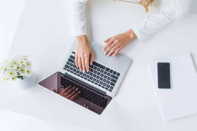 woman working on improving her website's EAT signals