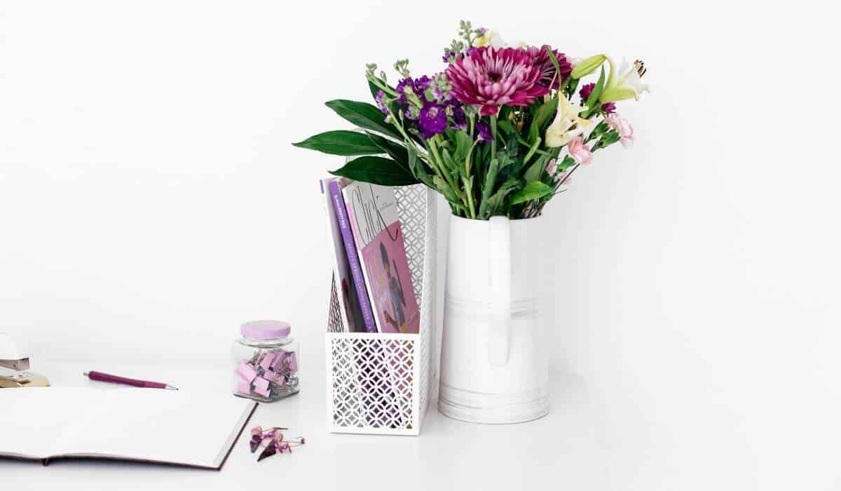 purple flowers on white desk
