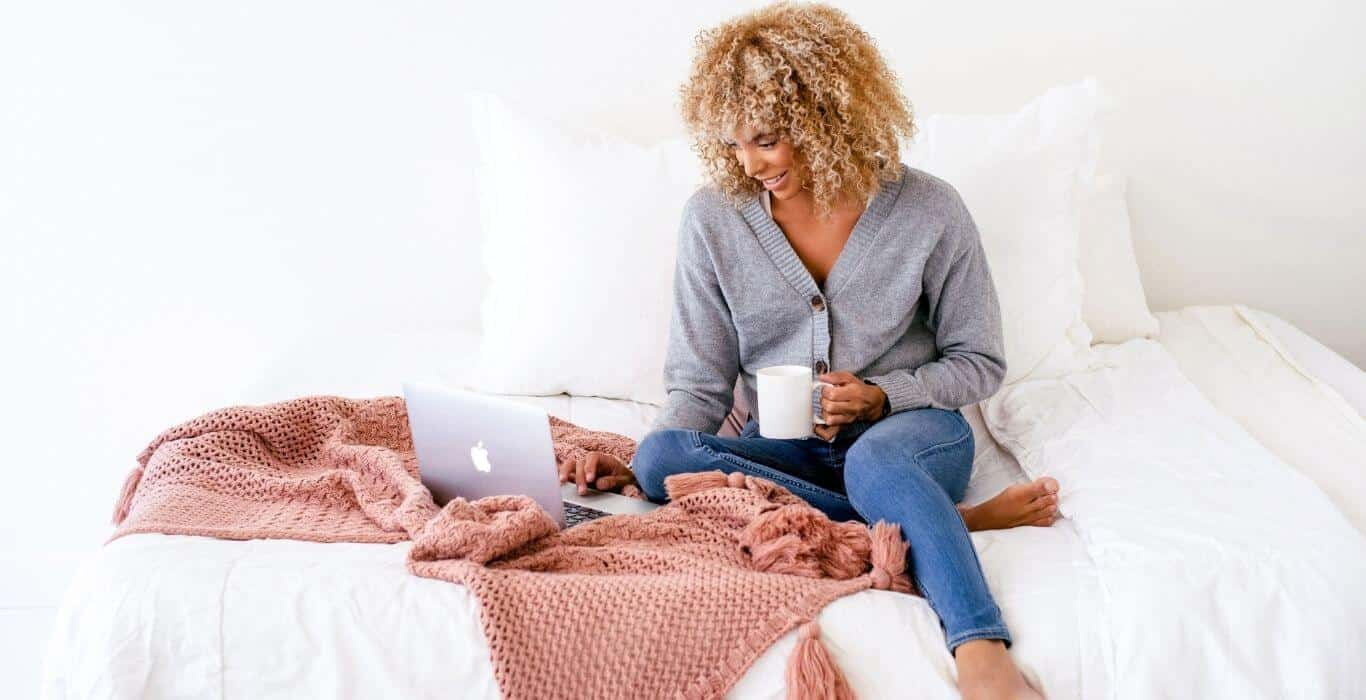 woman using Tailwind for her small business while working from her bed