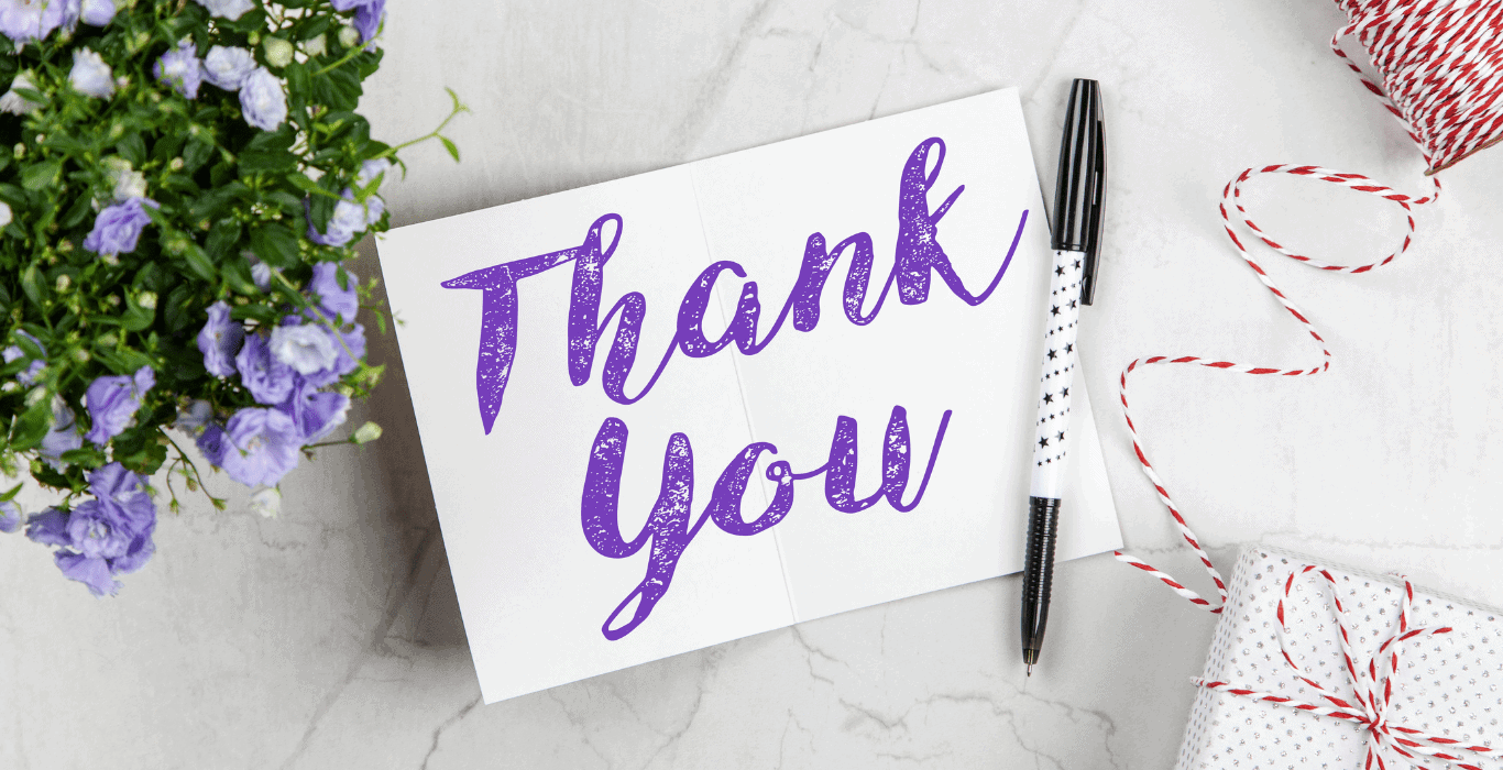 thank you written in purple ink on a white notecard
